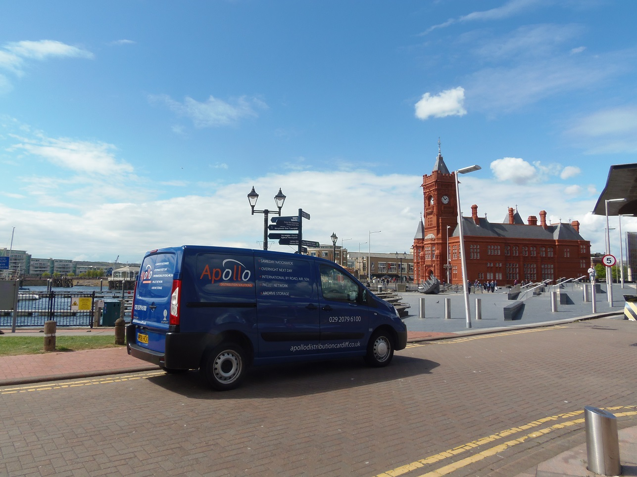 This picture shows an Apollo van outside the Pierhead Building in Cardiff delivering courier services nationwide from a small package to pallets. Either a dedicated same day service, overnight or international we can help with all your needs
